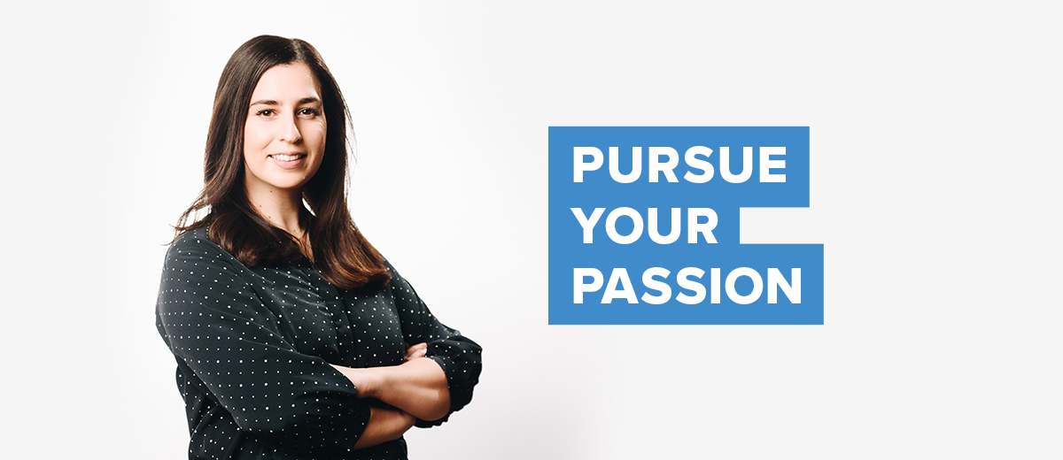 UConn business student, standing with arms crossed. Text overlay: Pursue Your Passion